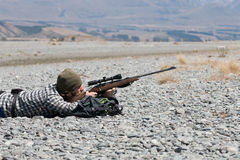 Hunter looking through rifle sight Royalty Free Stock Photos