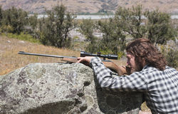 Hunter looking through the scope rifle Stock Photos