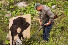 Hunter looking at shooting target Stock Photography