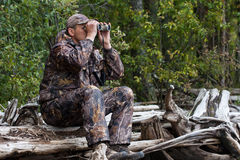 Hunter looks out the game Stock Photography