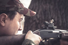 Hunter man aiming and prepared to make a shoot during hunting Stock Photo