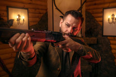 Hunter man aims of the antique hunting rifle Stock Photos