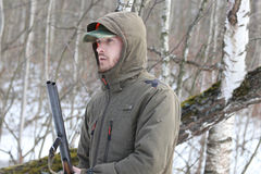 Hunter man in dark khaki clothing in the forest Stock Images
