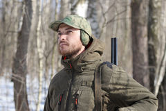 Hunter man in dark khaki clothing in the forest Stock Photography