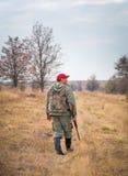 Hunter moving with shotgun Royalty Free Stock Photos