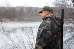 Hunter near the lake Royalty Free Stock Image