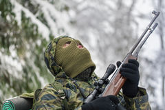 Hunter with optical rifle in winter Stock Photography
