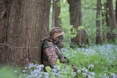 Hunter patiently waiting in the forest