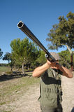 Hunter portrait. Hunter shooting at you focus on the weapon Royalty Free Stock Photography