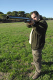 Hunter portrait. Hunter shooting at you focus on the weapon Stock Photo