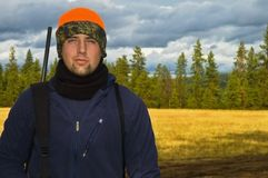 Hunter prepared to hunt. A portrait of a teenage hunter on his first hunt posed in front of a open meadow background stock photos