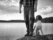 Hunter and puppy Royalty Free Stock Photos