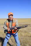 Hunter at Ready. A big game hunter with rifle in ready position Royalty Free Stock Photos