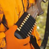 Hunter removing bullet. Close-up of hunter removing bullet from ammo holder on rifle Stock Photography