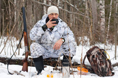 Hunter during the rest on winter hunting Stock Photo