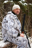 Hunter resting in winter forest Stock Photo