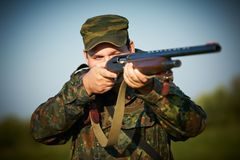 Hunter with rifle gun Stock Image