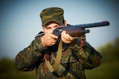 Hunter with rifle gun stock image