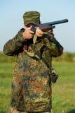 Hunter with rifle gun royalty free stock photo