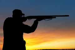 Hunter with rifle gun Royalty Free Stock Image