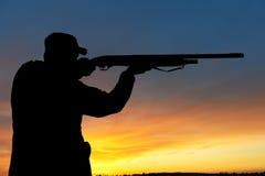 Hunter with rifle gun royalty free stock image