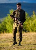 Hunter with rifle looking for animal. Hunting shooting trophy. Mental preparation for hunting individual process. Man. Rifle for hunt. Hunter khaki clothes stock photo