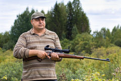 Hunter with a rifle Royalty Free Stock Photo