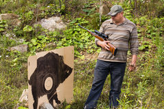 Hunter with rifle near the target Royalty Free Stock Photography