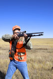Hunter With Rifle Shouldered. A big game hunter with rifle up to his shoulder to shoot Royalty Free Stock Photo