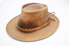 Hunter's hat. A well used hunters leather hat isolated on a white background Royalty Free Stock Photography