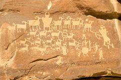 Hunter's Panel - Indian Petroglyph located in Nine Mile Canyon i. Fremont Indian petroglyph in Nine Mile Canyon (near Price, Utah) featuring hunters with bows Stock Photo