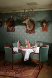 Hunter's Restaurant. Table at a restaurant with hunting decor royalty free stock image