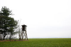 Hunter's stand. In the field near forest Royalty Free Stock Photography