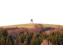 Hunter seat, deer stand on top of hill. Nice deer stand as hunters seat on the top of a hill. Free copy space above with forest in foreground. Image taken Royalty Free Stock Photos