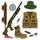 Hunter set in flat style. Camouflage hat, gun with shells, bandolier, knife, compass, army boots and hunter vest. Vector illustrat Stock Photos