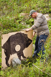Hunter setting the target for shooting Stock Photos