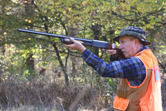 Hunter Shooting. Man hunting and taking a shot in the field Royalty Free Stock Photos