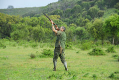 Hunter shooting. To small game Royalty Free Stock Photography