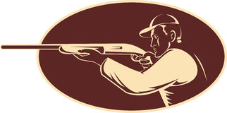 Hunter shooting aiming shotgun rifle. Illustration of a hunter shooting aiming shotgun rifle viewed from side woodcut set inside oval Royalty Free Stock Images