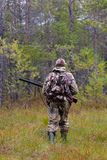Hunter shooting on the forest edge Royalty Free Stock Photography