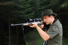 Hunter shooting with his rifle Royalty Free Stock Photos