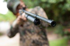 Hunter shooting rifle Stock Photography