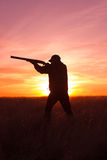 Hunter Shooting at  Sunset Royalty Free Stock Photos