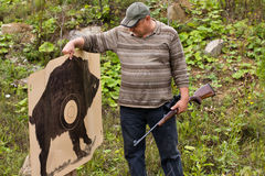 Hunter with shooting target Stock Image