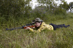 Hunter shooting up. A hunter aiming whit a rifle Stock Photos