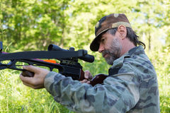 Hunter shoots a crossbow Stock Photo