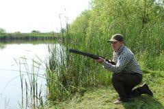 Hunter with shotgun. Duck hunting Royalty Free Stock Photo