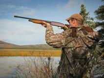 Hunter with Shotgun. Man with shotgun duck hunting Stock Images