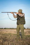 Hunter With Shotgun. On the field Stock Image