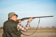 Hunter With Shotgun. On the field stock photography